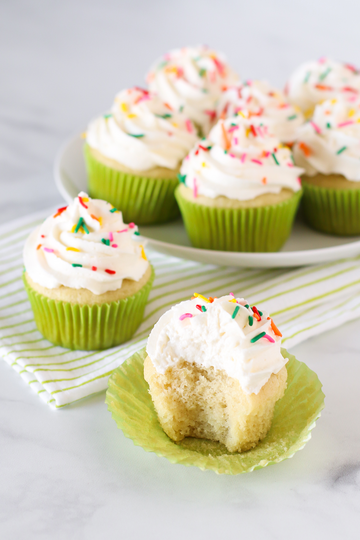 Gluten Free Vegan Vanilla Cupcakes. Light, fluffy cupcakes with a whipped, creamy vanilla buttercream. Allergen free and perfect for any celebration!