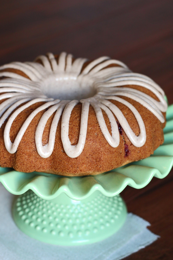 Gluten Free Vegan Apple Cranberry Bundt Cake. Moist apple cake, studded with fresh cranberries and topped with a cinnamon glaze.