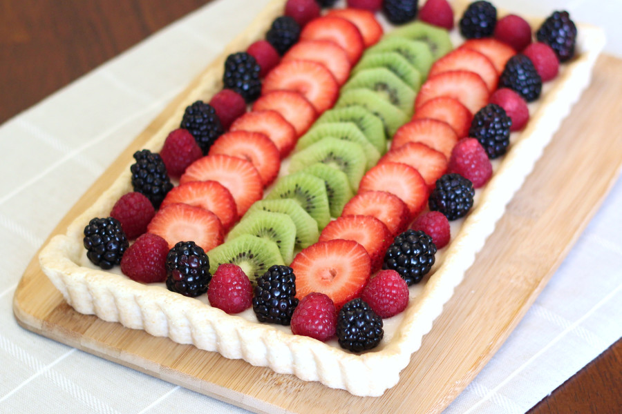 Gluten Free Vegan Fresh Fruit Tart. A bright and fresh dessert, perfect for springtime! Recipe found at Sarah Bakes Gluten Free.