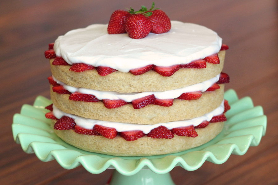 Gluten Free Vegan Strawberry Shortcake. Layers of fluffy vanilla cake, fresh strawberries and whipped coconut cream.