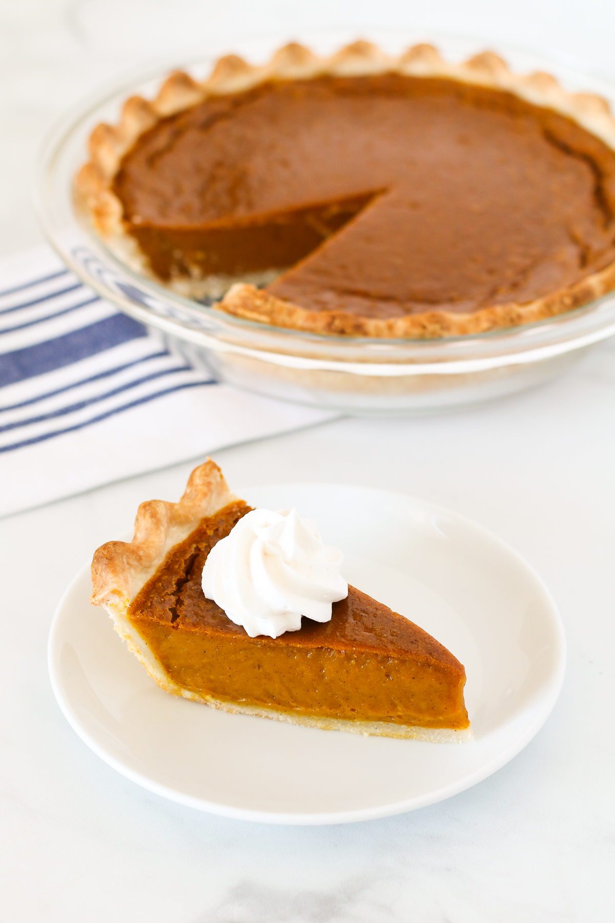 Gluten Free Vegan Pumpkin Pie. Flakey pie crust with a creamy, perfectly spiced pumpkin filling. This pumpkin pie is suitable for any holiday gathering!