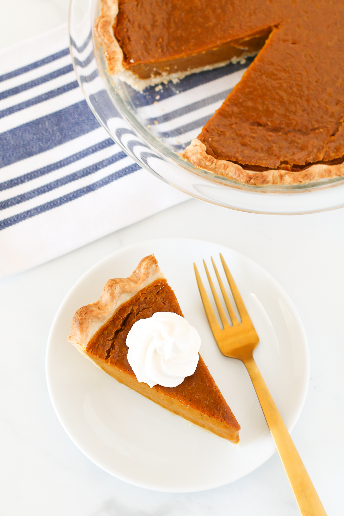 Gluten Free Vegan Pumpkin Pie. Flakey crust with a creamy, perfectly spiced pumpkin filling. This pumpkin pie is suitable for any holiday gathering!