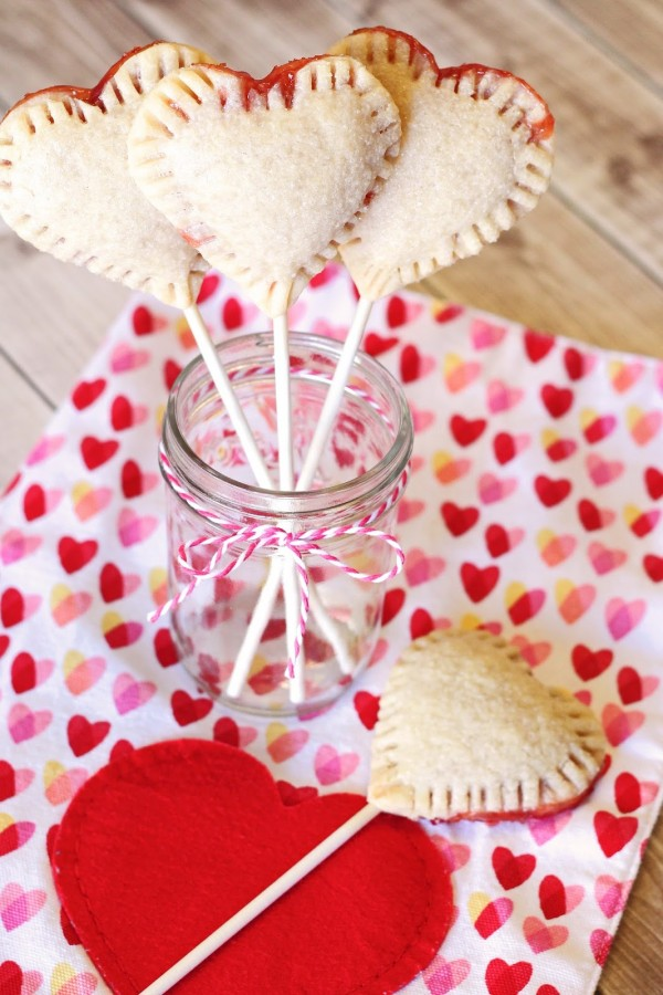 Gluten Free Vegan Heart Strawberry Pie Pops. Adorable little heart-shaped pie pops, filled with your favorite strawberry jam.