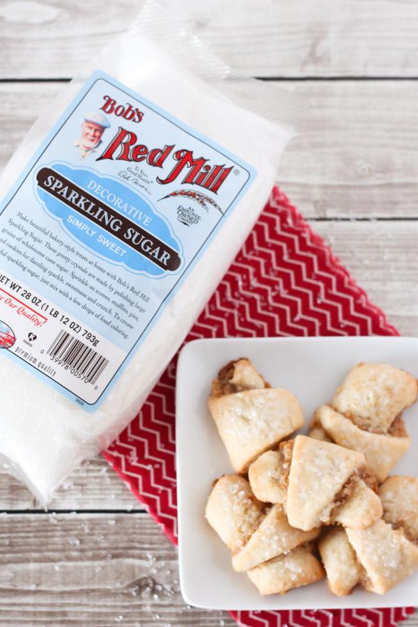 Gluten Free Vegan Walnut Crescent Cookies. Soft crescent cookies with a cinnamon walnut filling and a sprinkling of Bob's Red Mill sparkling sugar on top.
