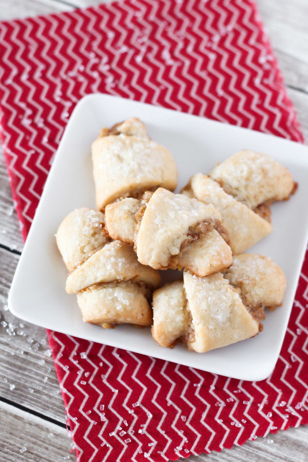 Gluten Free Vegan Walnut Crescent Cookies. Soft crescent cookies with a cinnamon walnut filling and a sprinkling of sparkling sugar on top.