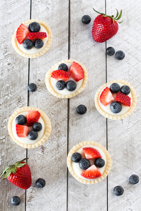 Gluten Free Vegan Mini Fresh Fruit Tarts. Light pastry, filled with lemon cream pudding and topped with fresh berries. A splendid spring dessert!