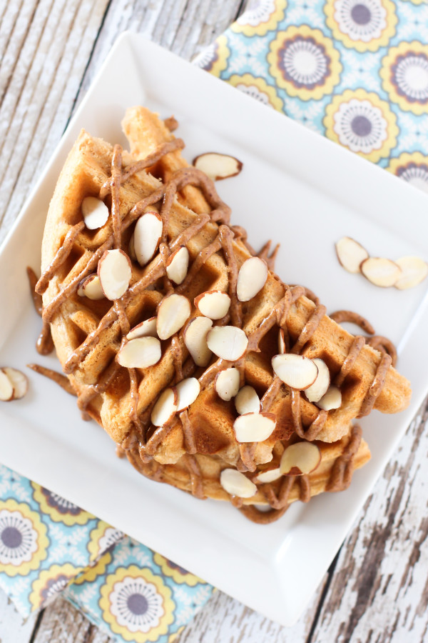 Gluten Free Vegan Vanilla Almond Protein Pancakes. With protein powder, almond flour, almond milk and a drizzle of almond butter, these waffles are PACKED with protein!