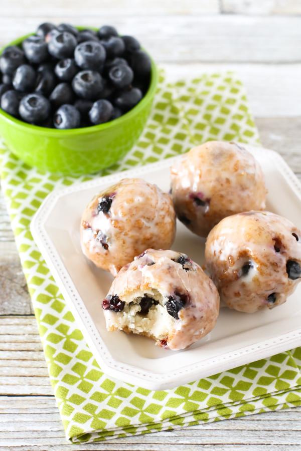 Gluten Free Vegan Blueberry Donut Holes. Crispy on the outside, fluffy on the inside. These donut holes are BURSTING with fresh blueberries!