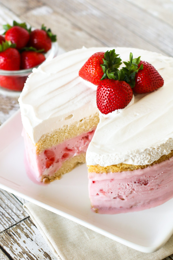 Gluten Free Vegan Strawberry Ice Cream Cake. Layers of vanilla cake, So Delicious Dairy Free strawberry ice cream and creamy Cocowhip. A gorgeous frozen treat!