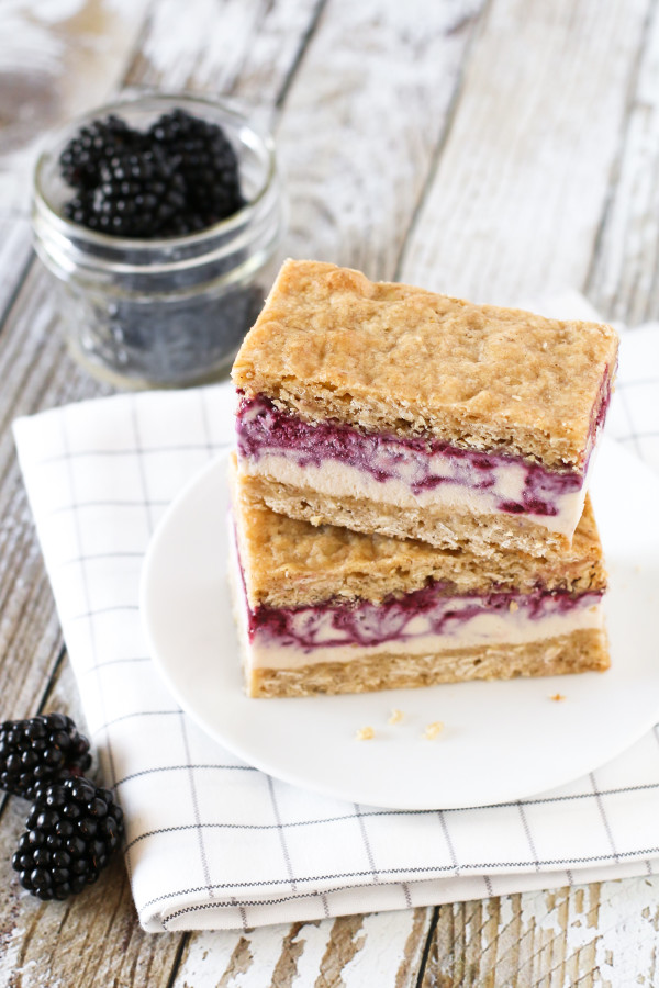 Gluten Free Vegan Blackberry Crisp Ice Cream Sandwiches. Creamy blackberry swirled cashew milk ice cream, sandwiched between two oatmeal crisp cookies.