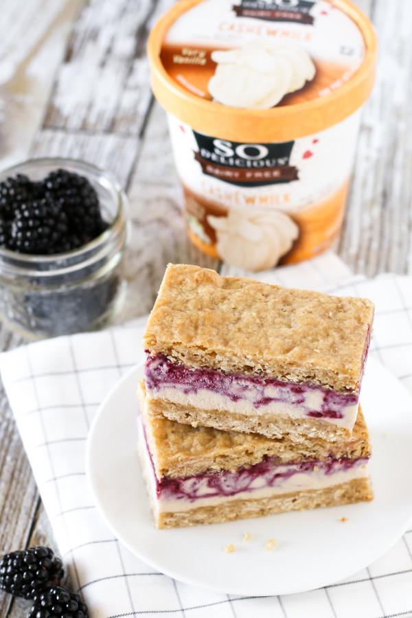 Gluten Free Vegan Blackberry Crisp Ice Cream Sandwiches. Creamy blackberry swirled So Delicious cashew milk ice cream, sandwiched between two oatmeal crisp cookies.