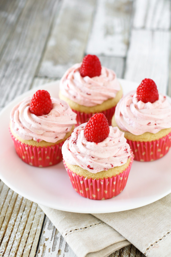 Gluten Free Vegan Raspberry Vanilla Cupcakes. Fluffy vanilla cupcake, topped with a fresh raspberry buttercream. Delightful!