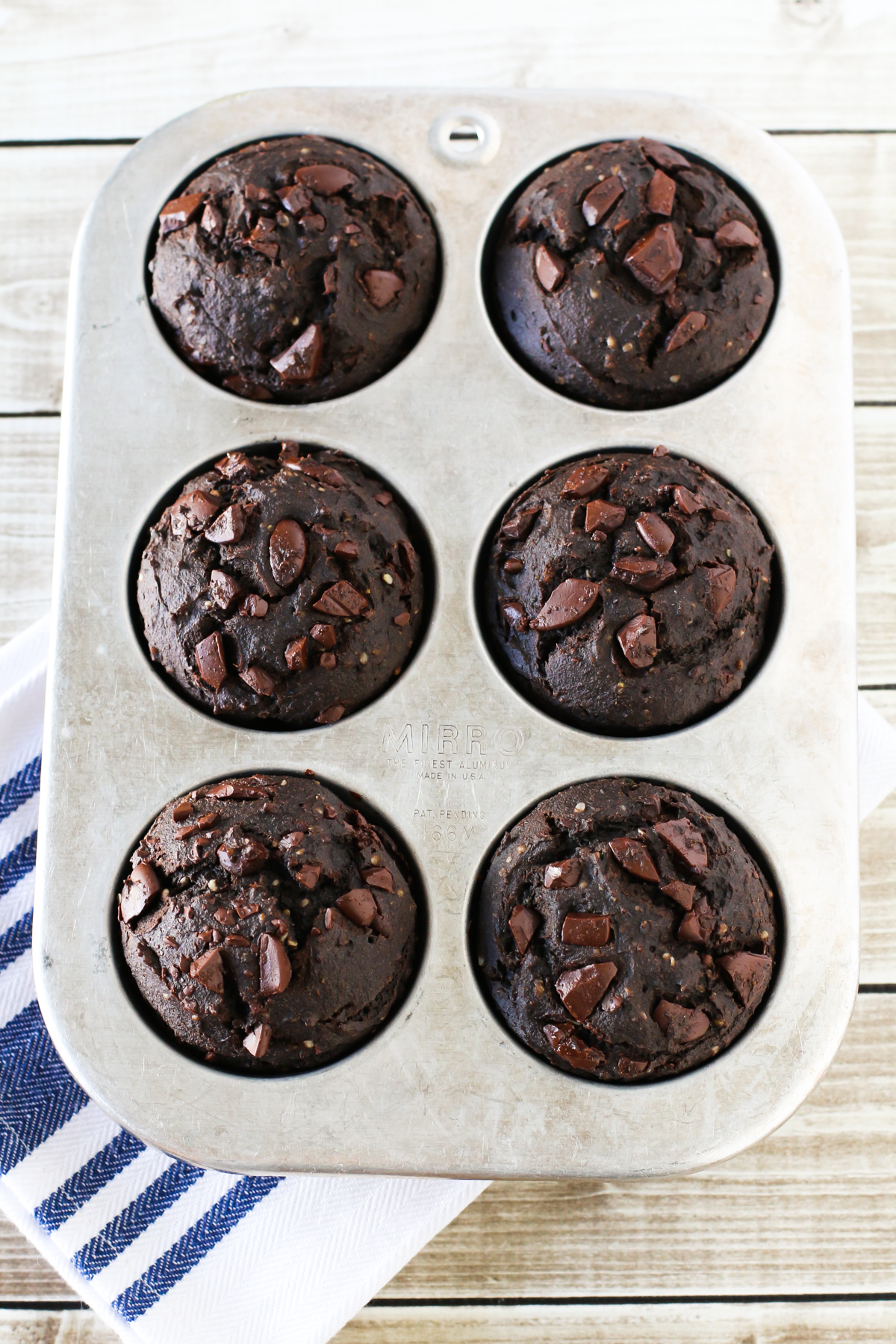 Gluten Free Vegan Dark Chocolate Muffins. Refined sugar free, these muffins are even packed with protein and a secret ingredient!