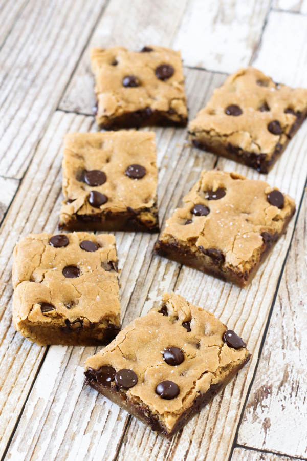Gluten Free Vegan Salted Chocolate Chip Cookie Bars. Chewy, gooey, chocolatey cookies with a sprinkling of sea salt.