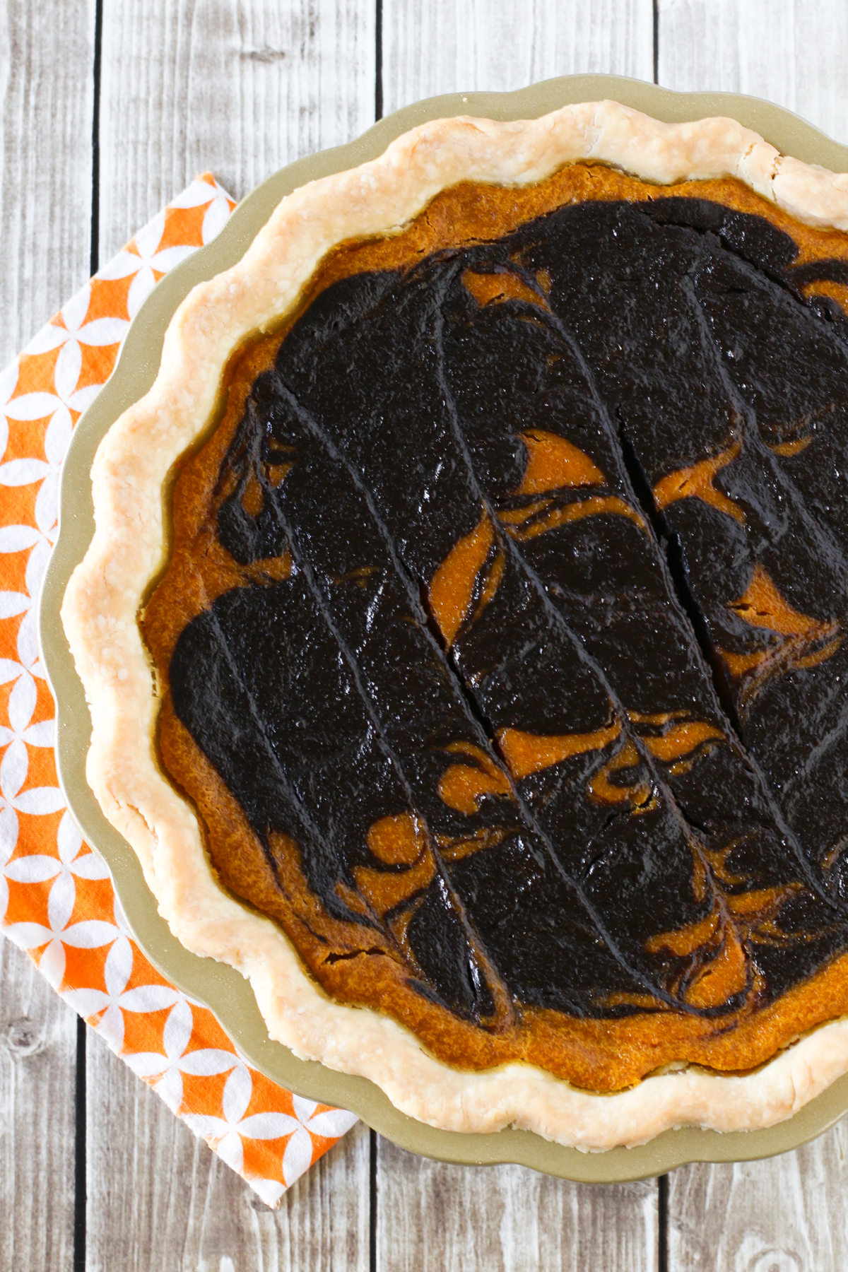 Gluten Free Vegan Chocolate Swirled Pumpkin Pie. Classic pumpkin pie with a chocolate twist!