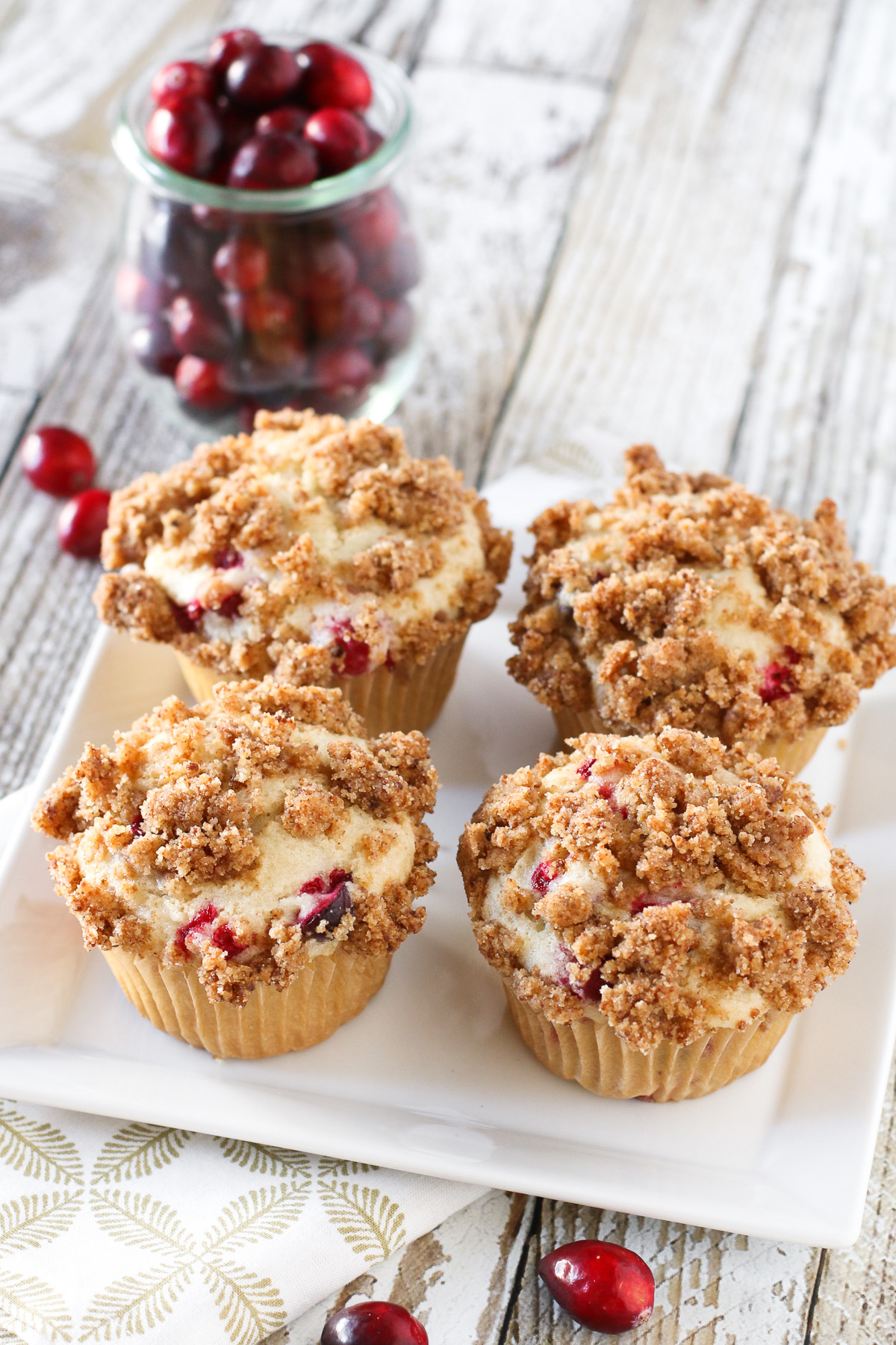 Gluten Free Vegan Cranberry Coffeecake Muffins. Fluffy vanilla cake, studded with fresh cranberries and topped with a crunchy cinnamon topping.
