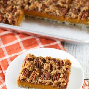 Gluten Free Vegan Pecan Pumpkin Pie Bars. Oat crust, creamy pumpkin filling and sugar crumble pecan topping. Easy-peasy and a fall favorite!