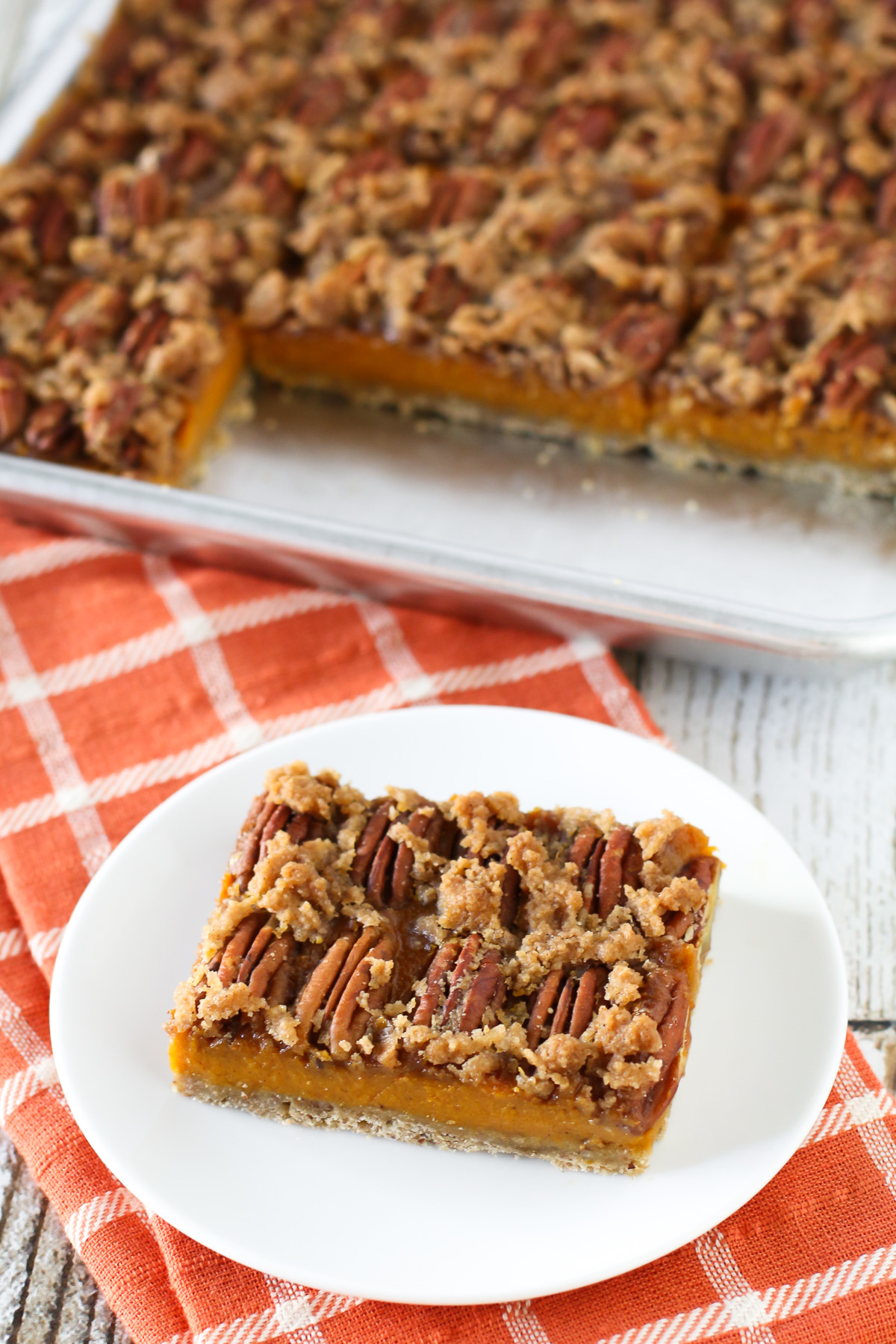 Gluten Free Vegan Pecan Pumpkin Pie Bars. Oat crust, creamy pumpkin filling and sugar crumble pecan topping. Easy-peasy and a fall favorite!