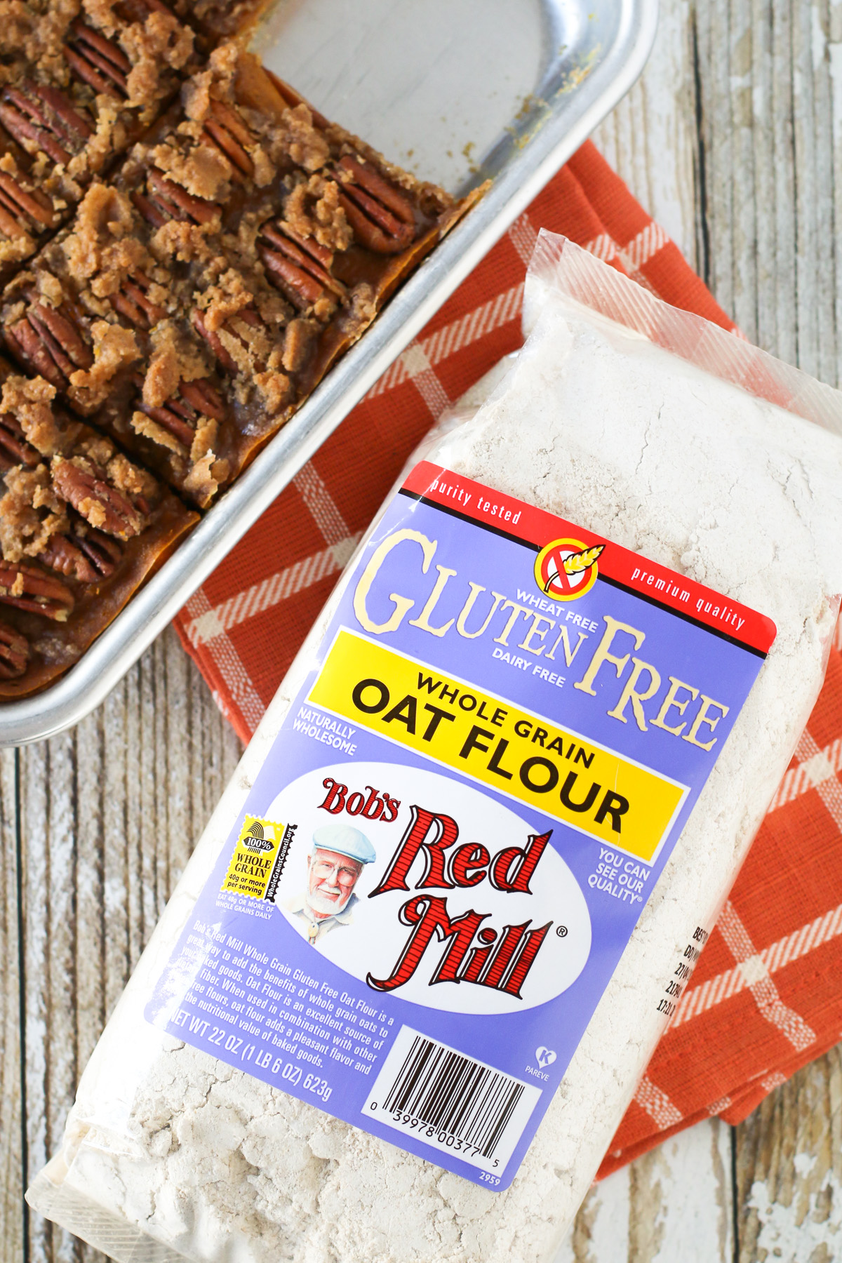 Gluten Free Vegan Pecan Pumpkin Pie Bars. Oat crust made with Bob's Red Mill gluten free oat flour, creamy pumpkin filling and sugar crumble pecan topping.
