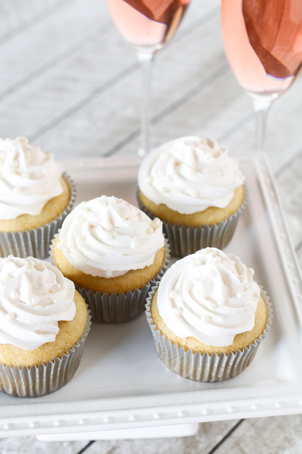 Gluten Free Vegan Champagne Cupcakes. Light vanilla cupcakes, infused with champagne and topped with a champagne buttercream. Cheers!
