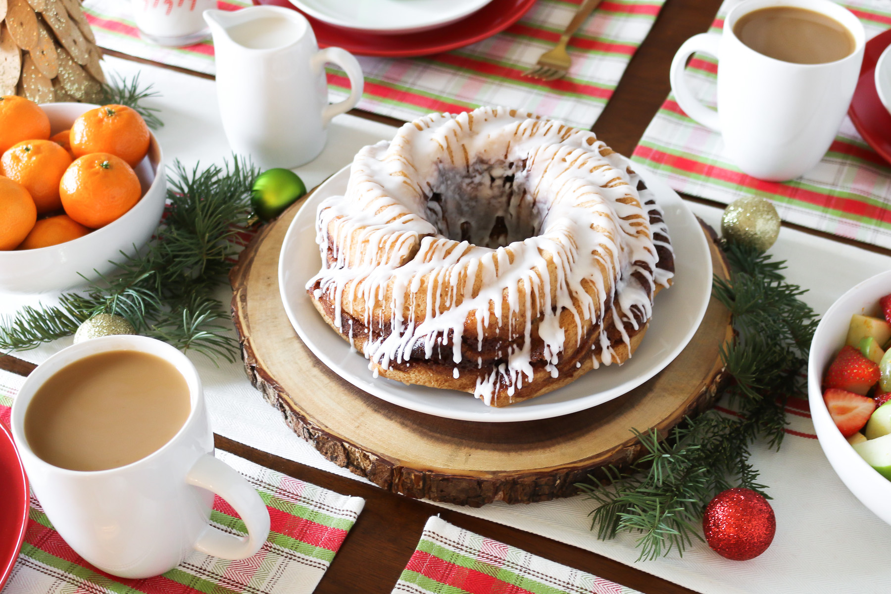 Gluten Free Vegan Cinnamon Roll Coffee Cake. Layers of light vanilla cake and cinnamon sugar, baked to perfection. A beautiful centerpiece for your holiday brunch!