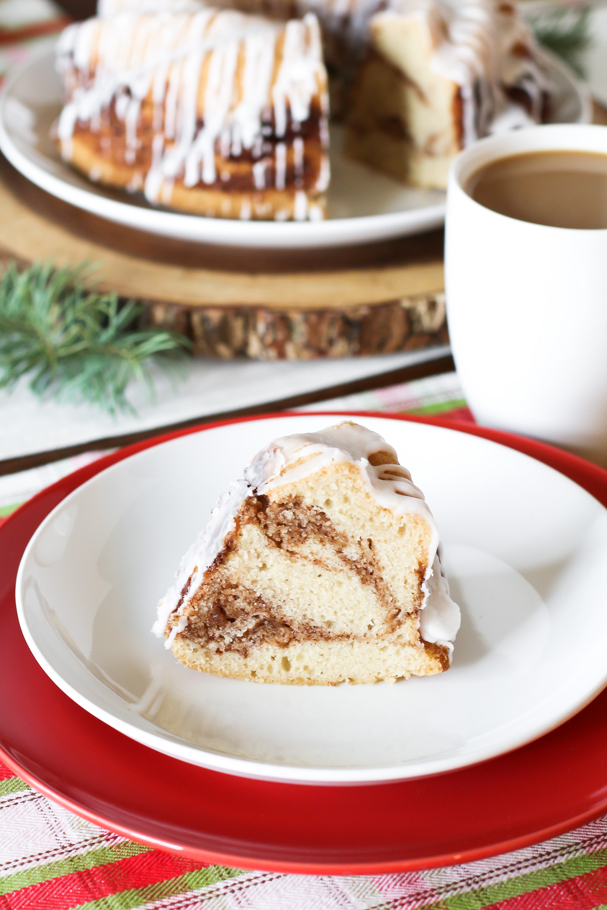 Gluten Free Vegan Cinnamon Roll Coffee Cake. Layers of light vanilla cake and cinnamon sugar, baked to perfection. That simple glaze over the top is a must!