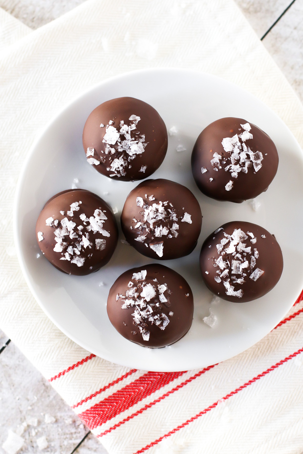 Gluten Free Vegan Sea Salt Brownie Truffles. These decadent brownie truffles are coated in dark chocolate and a sprinkling of sea salt flakes.
