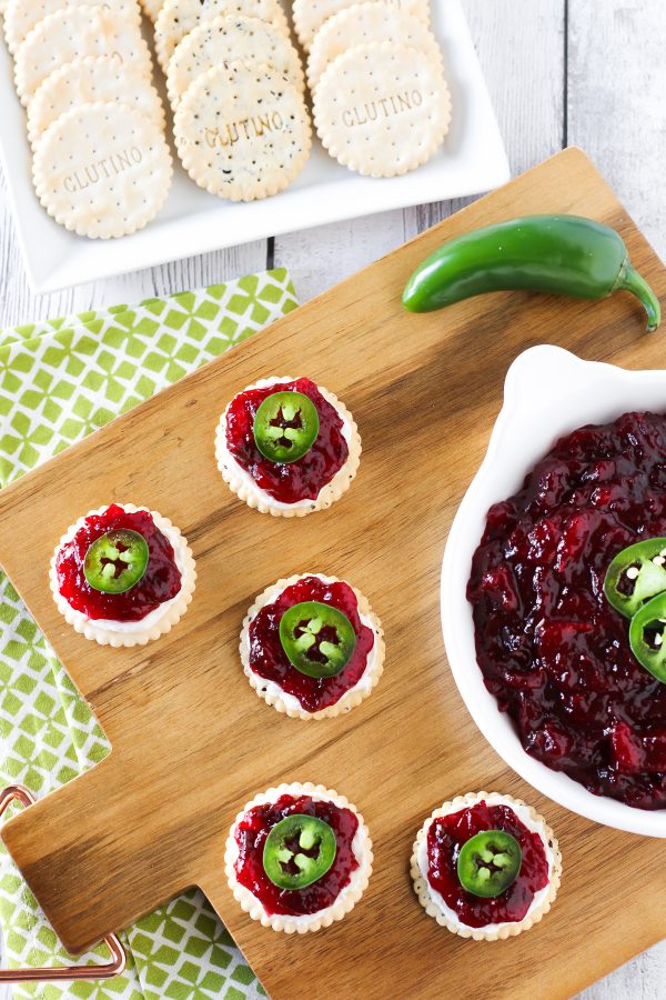 Sweet and Spicy Cranberry Jalapeño Chutney. Served on top of Glutino gluten free crackers with a little dairy free cream cheese and fresh jalapeño slices.