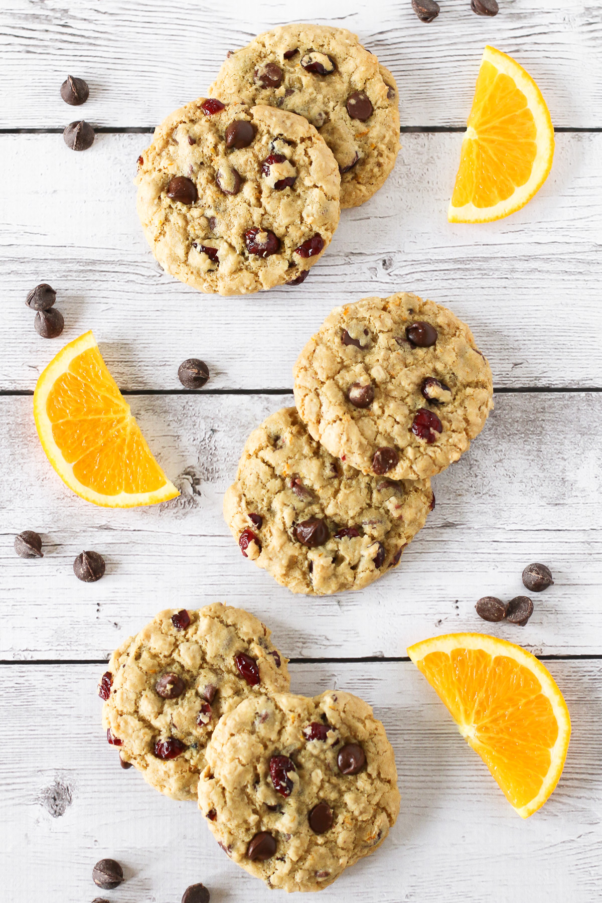 Gluten Free Vegan Cranberry Orange Chocolate Chip Cookies. Chewy cookies with orange zest, dried cranberries and lots of dark chocolate chips!