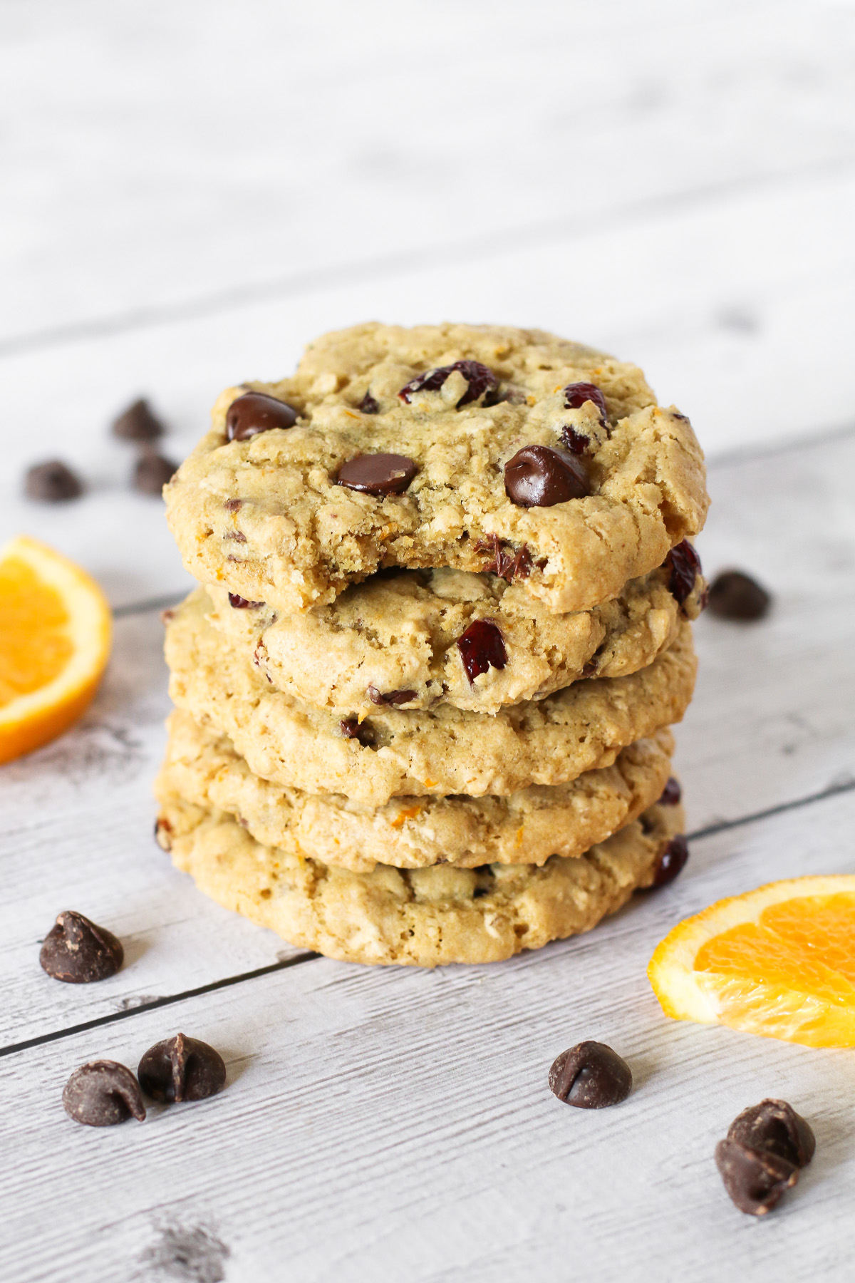 Gluten Free Vegan Cranberry Orange Chocolate Chip Cookies. Chewy cookies with fresh orange zest, sweet dried cranberries and lots of dark chocolate chips!