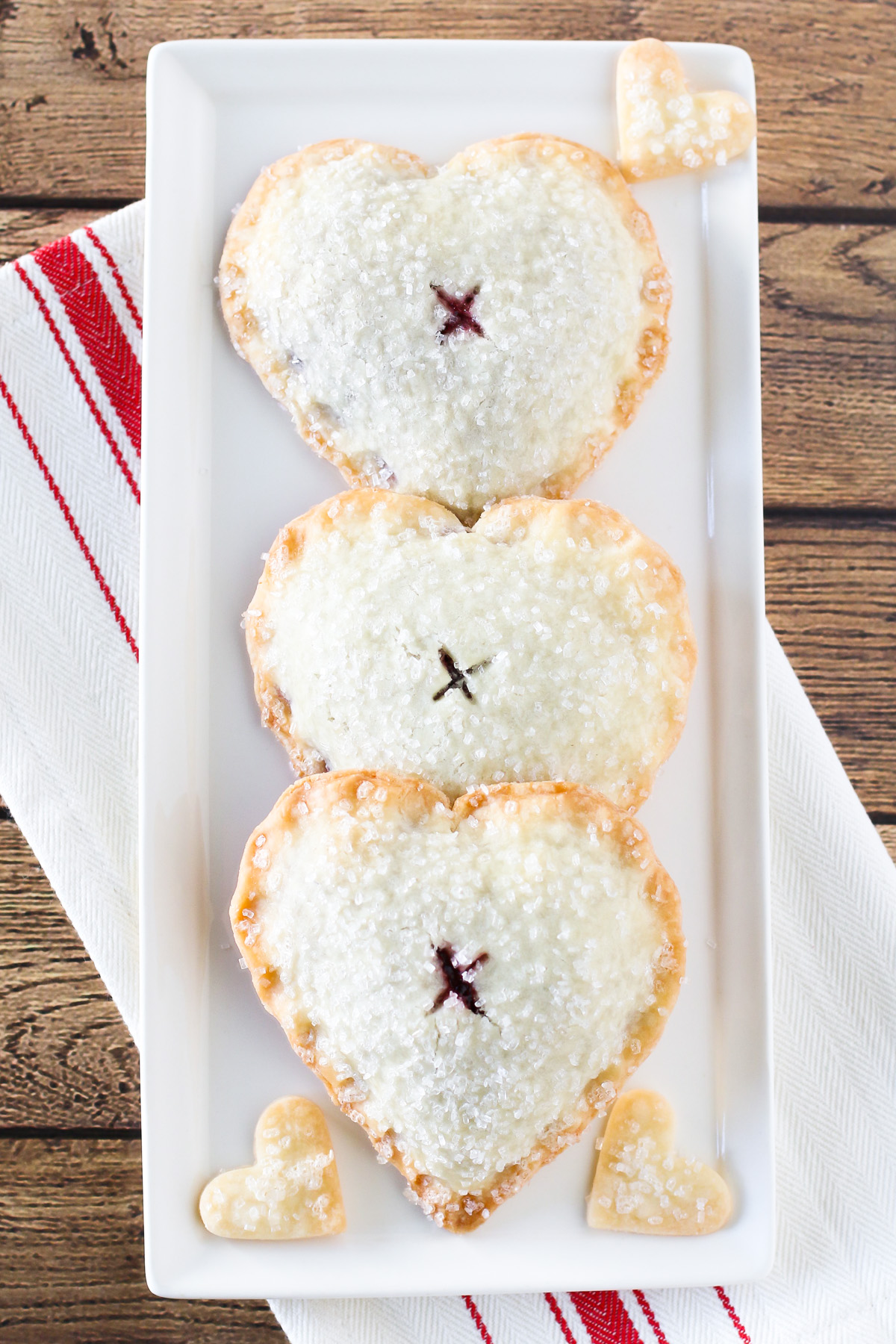Gluten Free Vegan Sweetheart Cherry Hand Pies. Heart-shaped flakey pastry with a sweet, dark cherry filling.