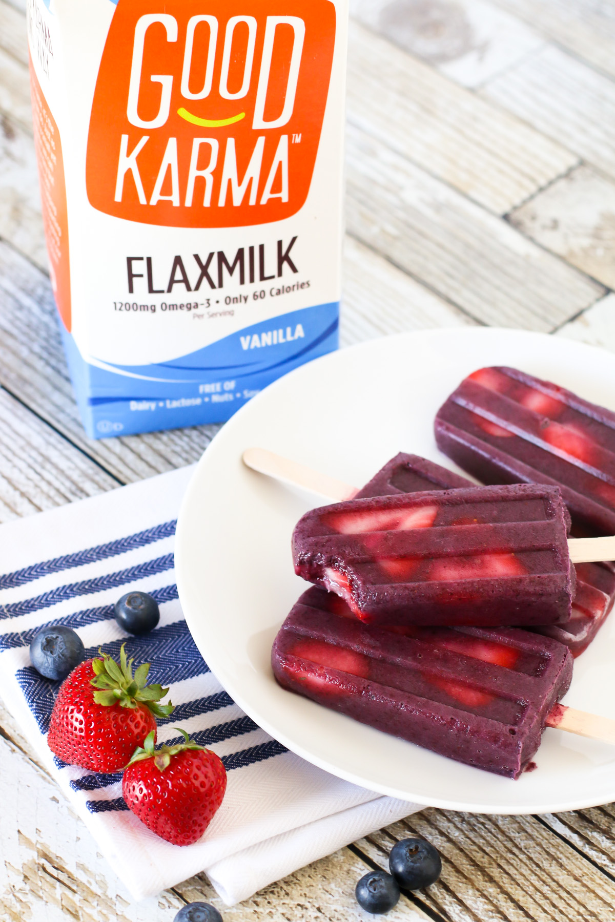 Berry Smoothie Popsicles. Made with Good Karma Flaxmilk, these berry smoothie popsicles are perfect for summer!