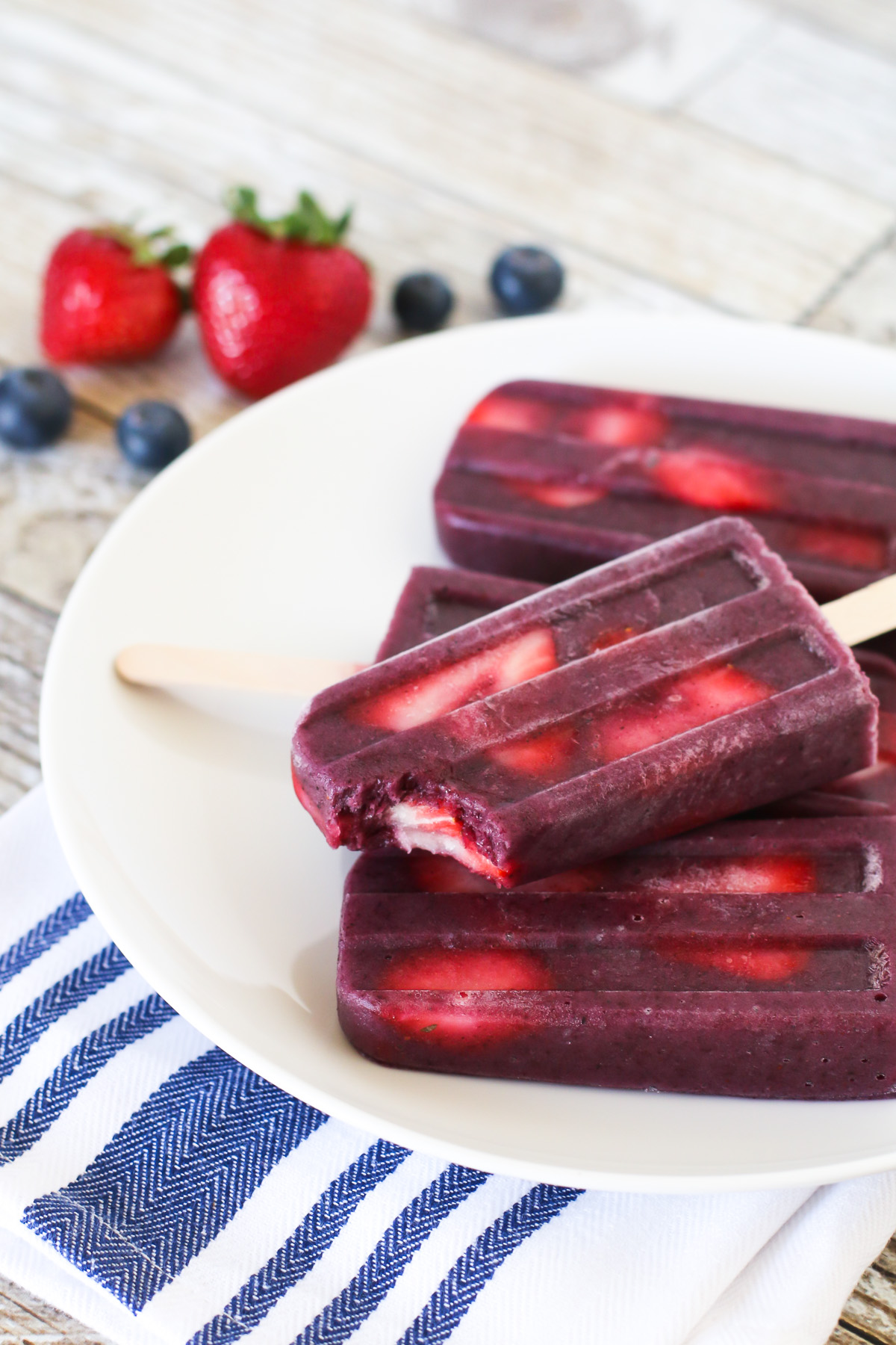 Berry Smoothie Popsicles. These perfect for summer smoothie popsicles are made with blueberries, bananas, flaxmilk and slices of fresh strawberries.