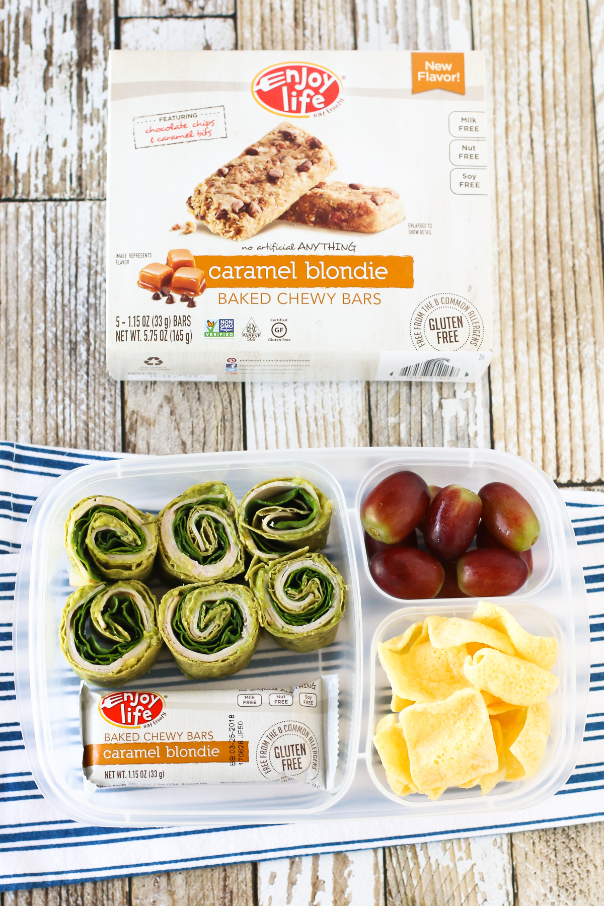Easy Allergen Free School Lunches. Gluten free turkey, spinach and guacamole pinwheels, served with an Enjoy Life Baked Chewy Bar.