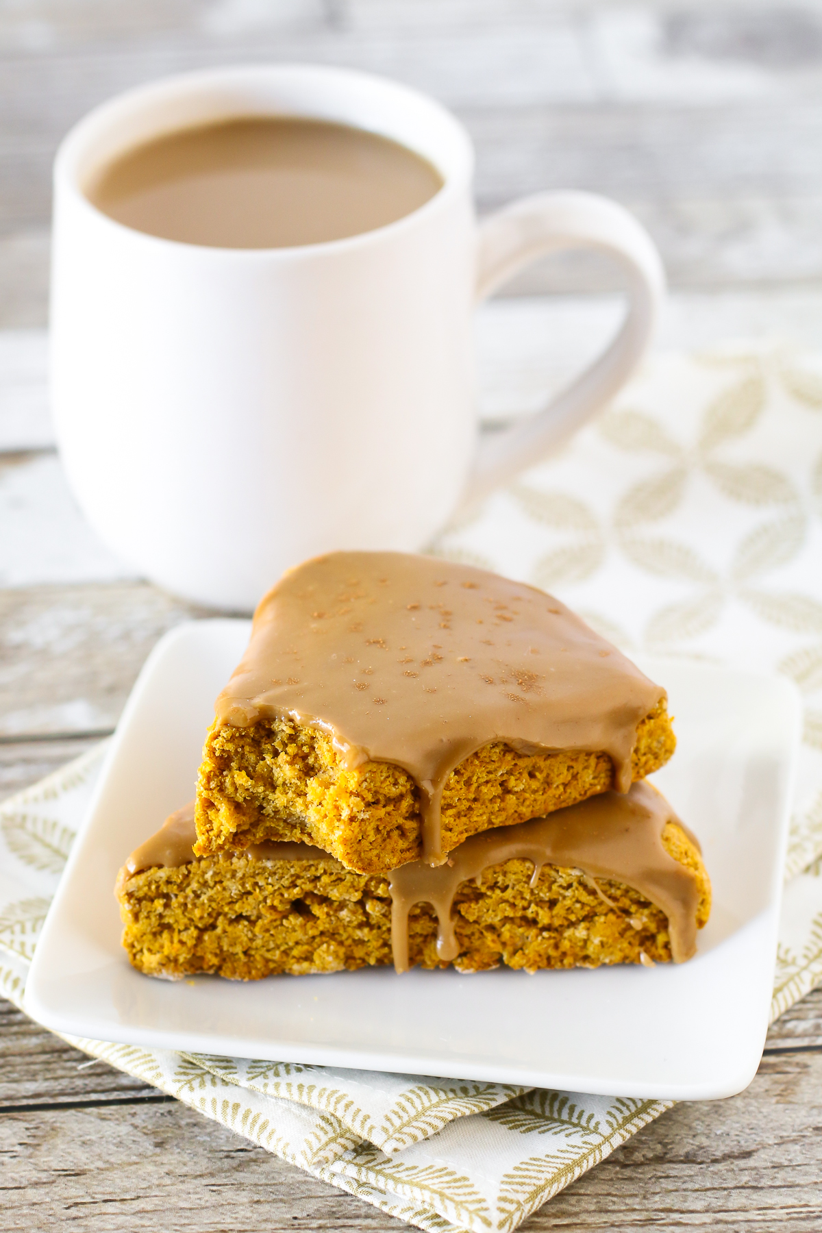 Gluten Free Vegan Pumpkin Spice Latte Scones. Tender pumpkin scones with a simple espresso glaze. So dreamy!