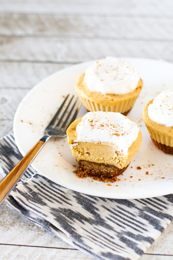 Gluten Free Vegan Mini Pumpkin Cheesecakes. Creamy cashew based cheesecakes with pumpkin and all the fall spices.