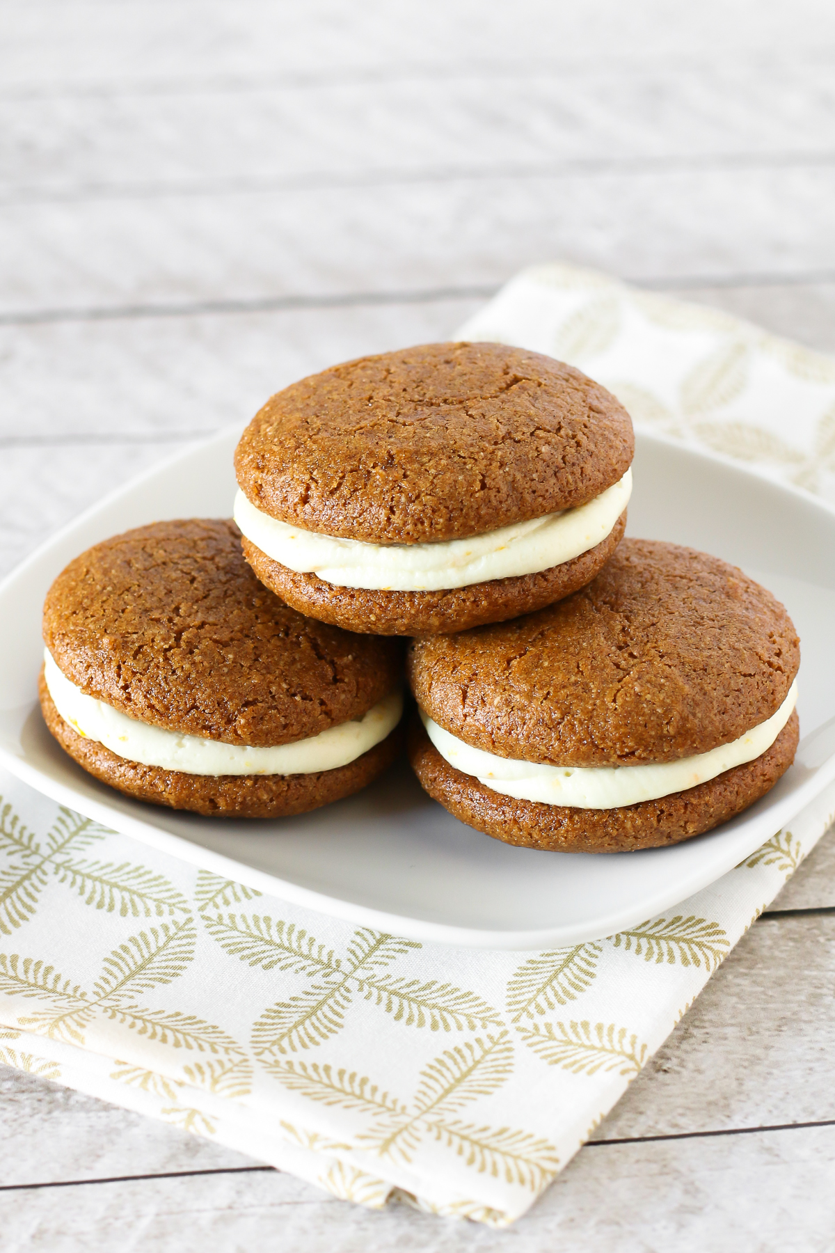 Gluten Free Vegan Gingerbread Whoopie Pies. Soft cake-like gingerbread cookies with a dairy free orange buttercream filling. Heavenly!