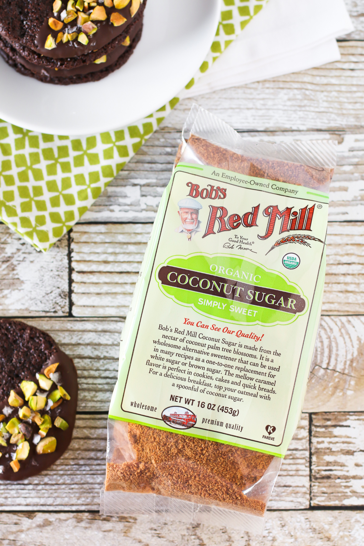 Grain Free Vegan Sea Salt Pistachio Chocolate Cookies. Made with Bob's Red Mill Coconut Sugar, these chocolate-dipped cookies are quite decadent!