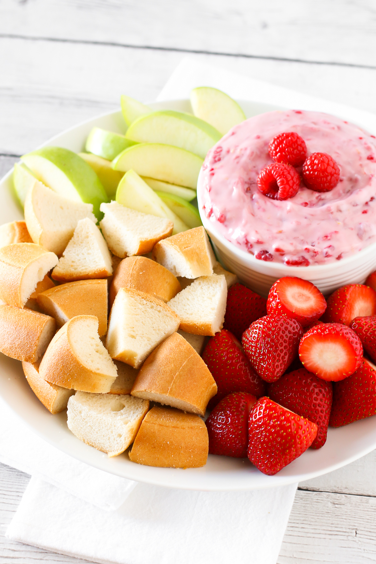 Dairy Free Raspberry Cheesecake Dip. Creamy cheesecake dip, with lemon and fresh raspberries. It's pinkalicious!