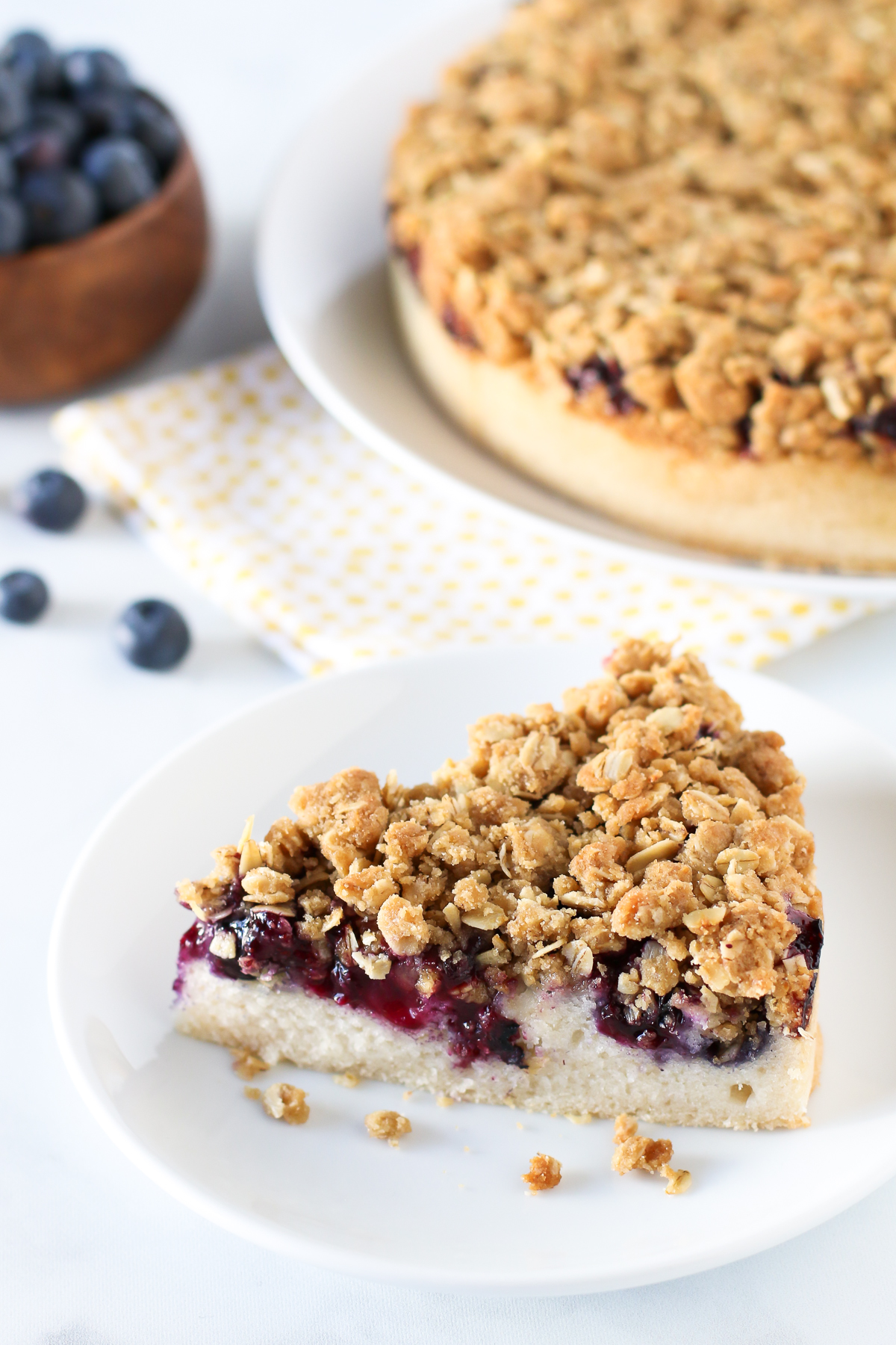 Gluten Free Vegan Blueberry Coffee Cake. Light vanilla cake with a layer of fresh, juicy blueberries and an oat crumb topping.