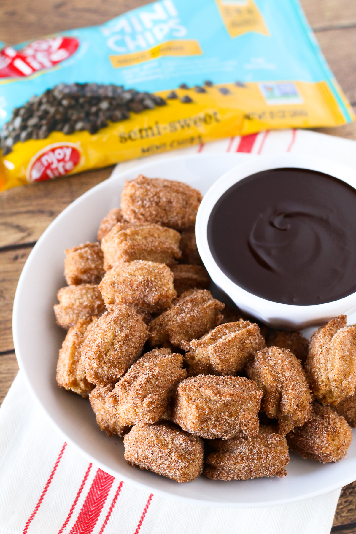 Gluten Free Vegan Churro Bites with Chocolate Sauce. Bite-size fried churros, served with a chocolate sauce made with Enjoy Life chocolate chips!