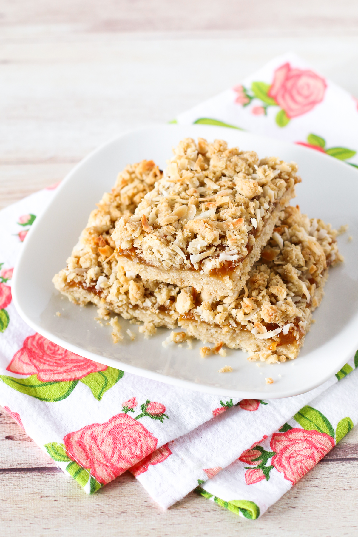 Gluten Free Vegan Apricot Coconut Crumb Bars. Coconut oat crumble with a layer of sweet apricot jam. You can't eat just one of these easy-to-make bars!