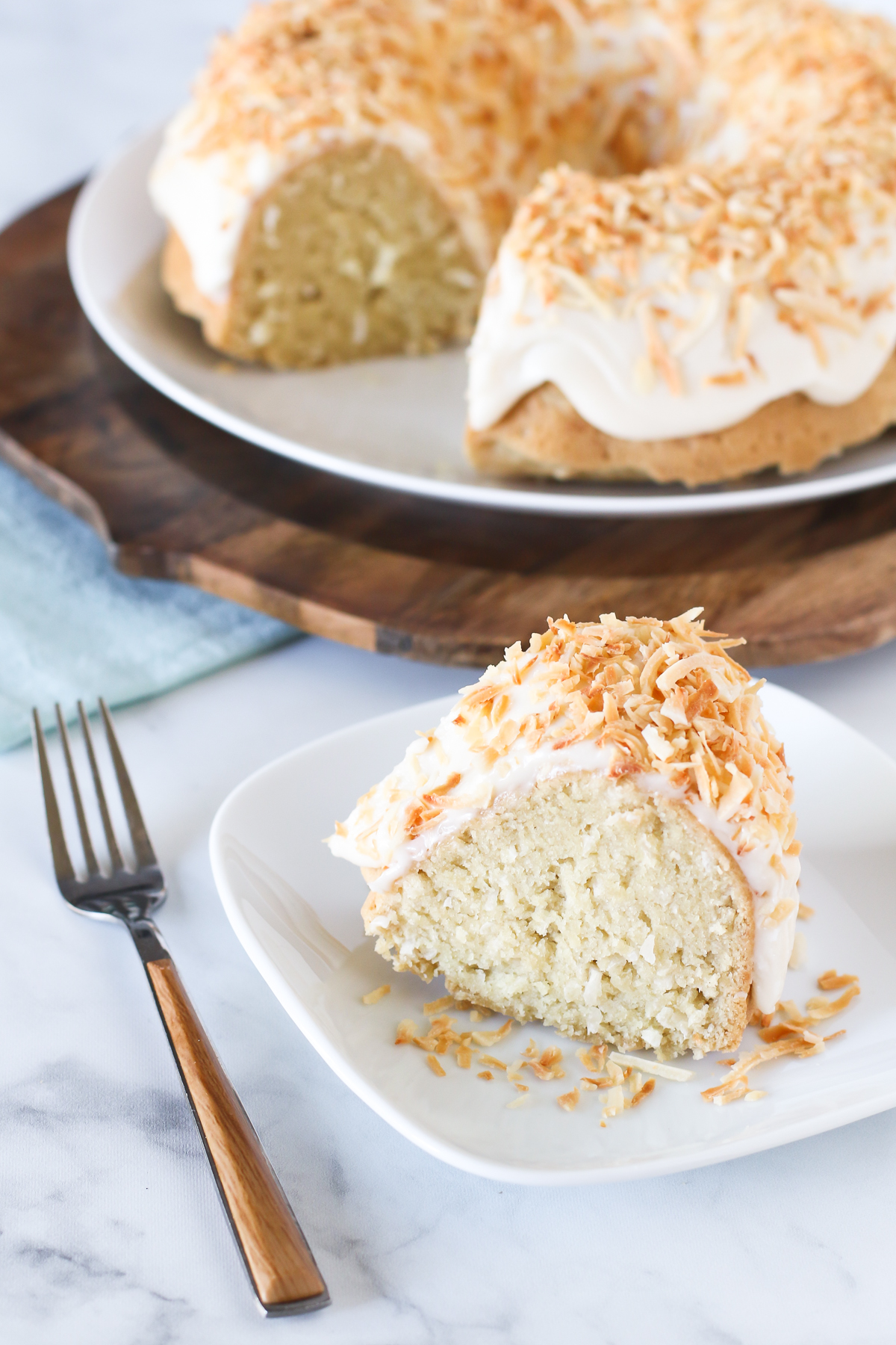 Gluten Free Vegan Coconut Bundt Cake. Give me all the coconut! Coconut cake with a simple frosting and covered in toasted coconut.