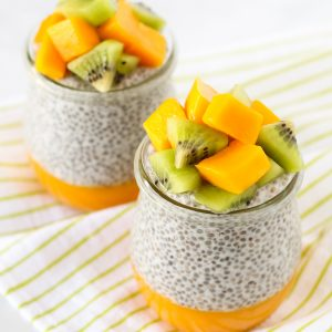 Dairy Free Mango Chia Pudding. Layers of fresh mango puree, vanilla chia seed pudding and fresh fruit. A tropical treat!