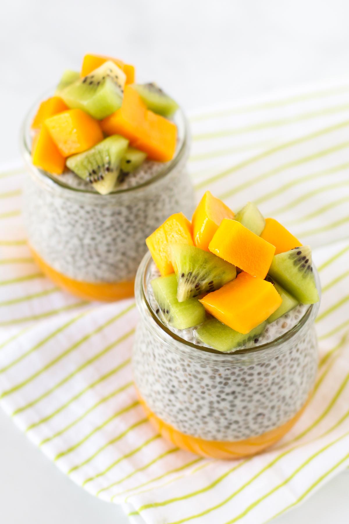 Dairy Free Mango Chia Pudding. Layers of fresh mango puree, vanilla chia seed pudding and fresh fruit. A tropical treat!