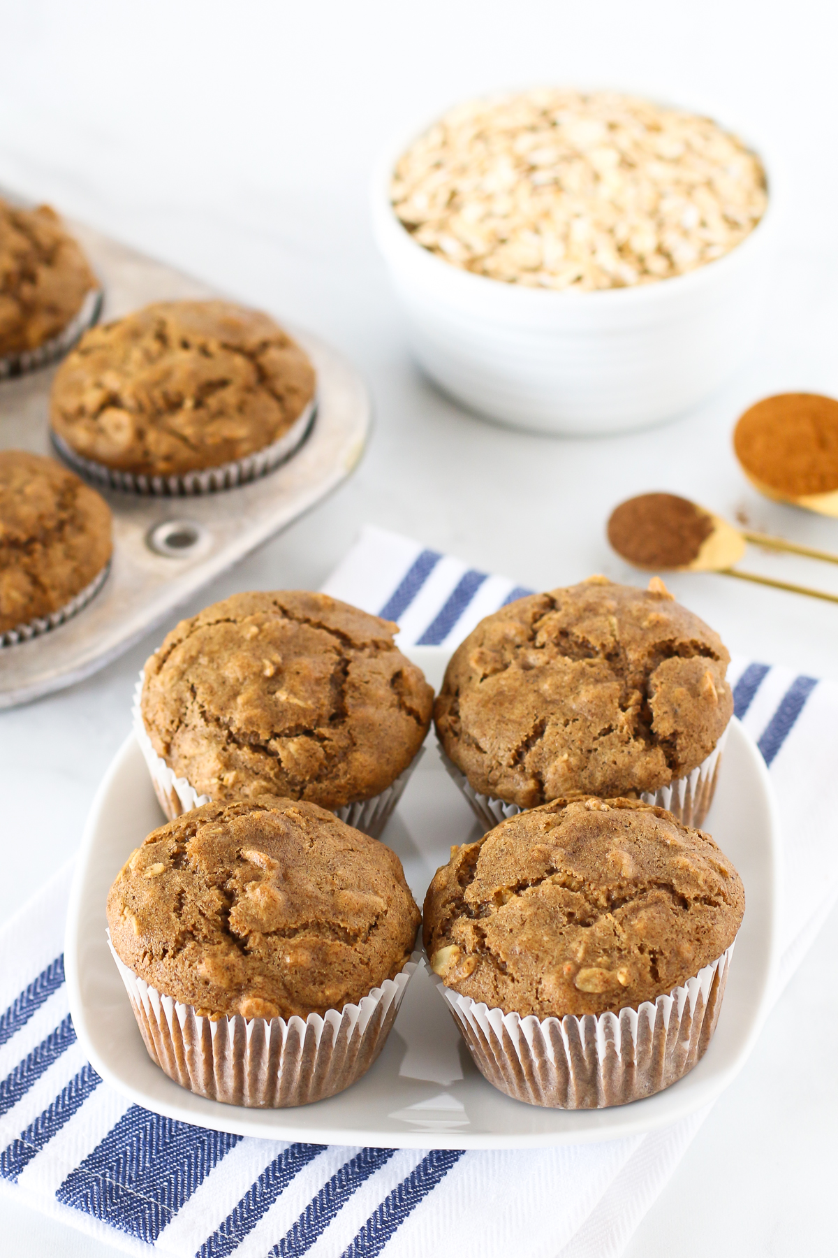 Gluten Free Vegan Oatmeal Spice Muffins. These tender muffins are filled with oats and warm spices, making them a lovely morning treat.