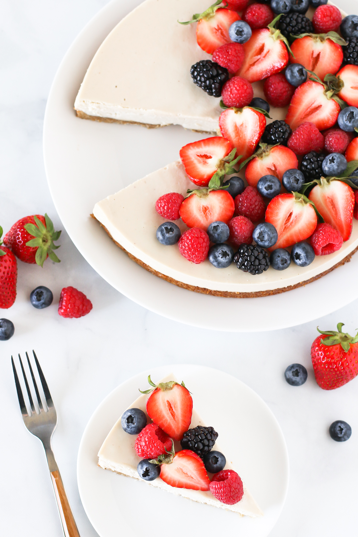 Gluten Free Vegan Berry Cheesecake. You will go head over heals for this dairy free cheesecake! Made with cashews, the creamy texture is perfectly paired with the fresh berries.
