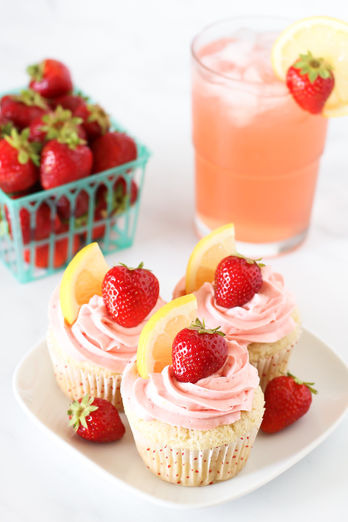 Gluten Free Vegan Strawberry Lemonade Cupcakes. Light, fluffy lemon cupcakes with a fresh strawberry buttercream. Tastes like summer!