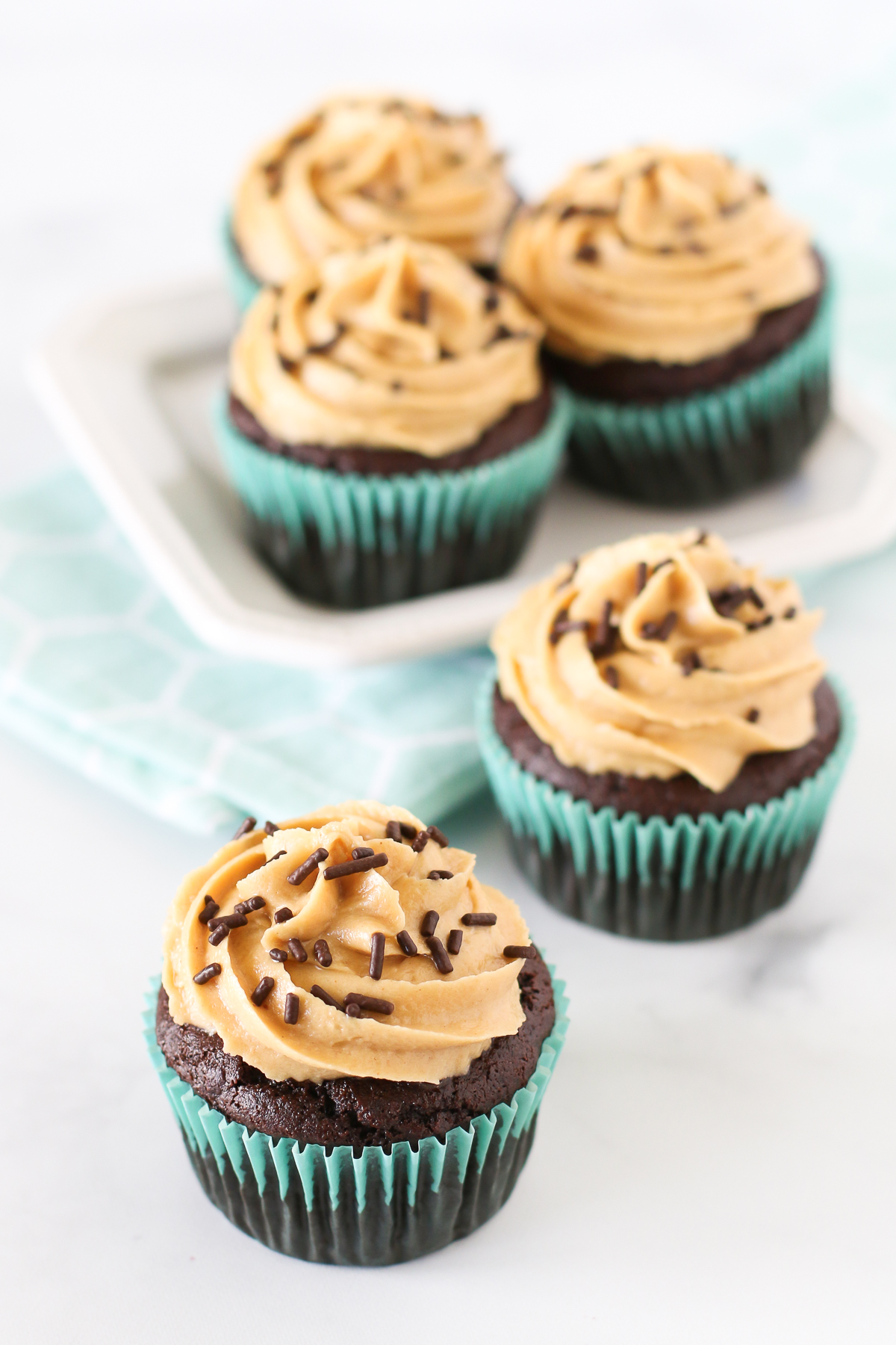 Gluten Free Vegan Chocolate Peanut Butter Cupcakes. Fluffy chocolate cupcakes with a creamy, dreamy peanut butter frosting.