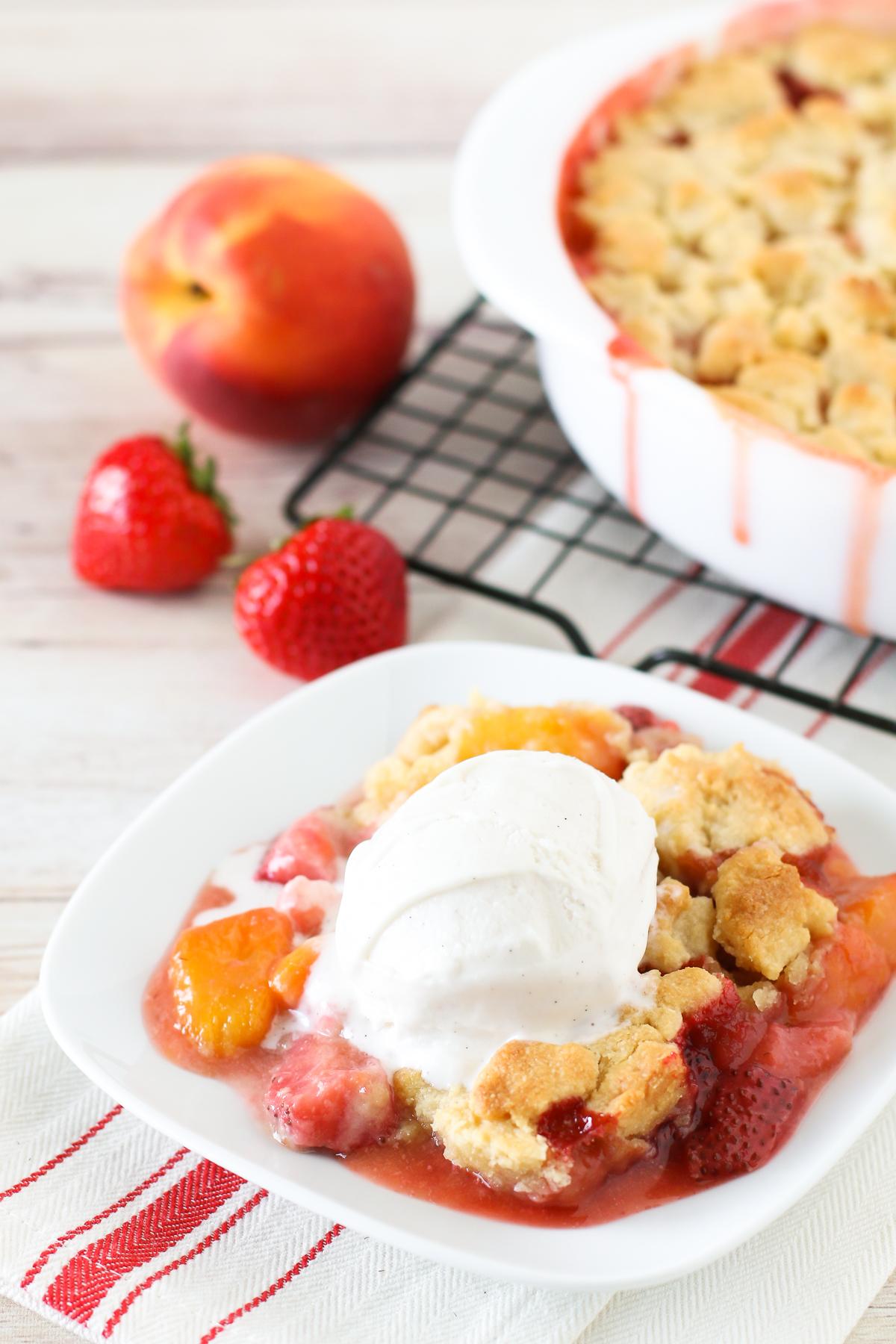 Grain Free Vegan Strawberry Peach Crisp. Golden grain free crisp topping over sweet, juicy strawberries and peaches.